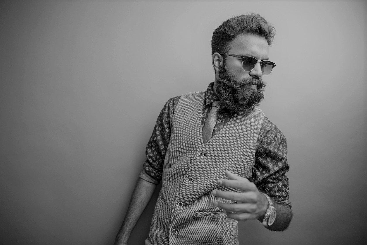 A man with a beardstache