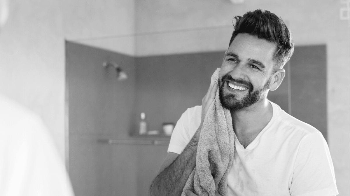 man looking at his beard