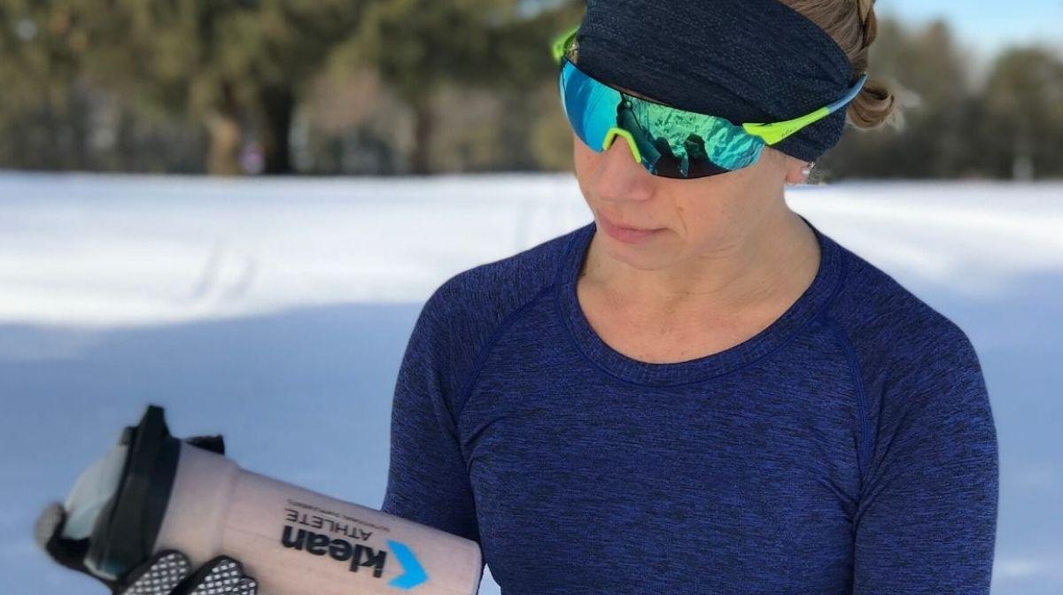 athlete using Klean Isolate Whey Protein Powder