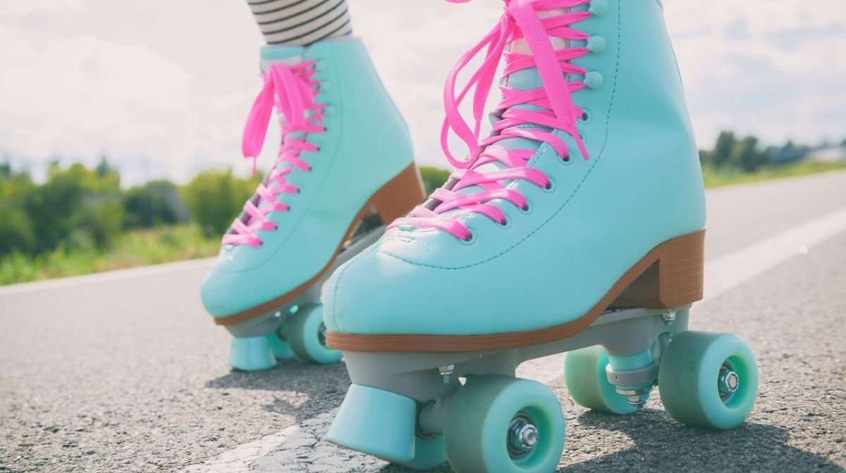 Woman wearing roller skates with pink laces