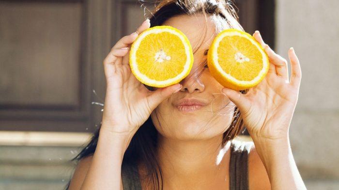 woman holding orange segments