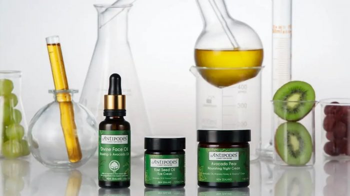sustainable skincare products next to scientific equipment