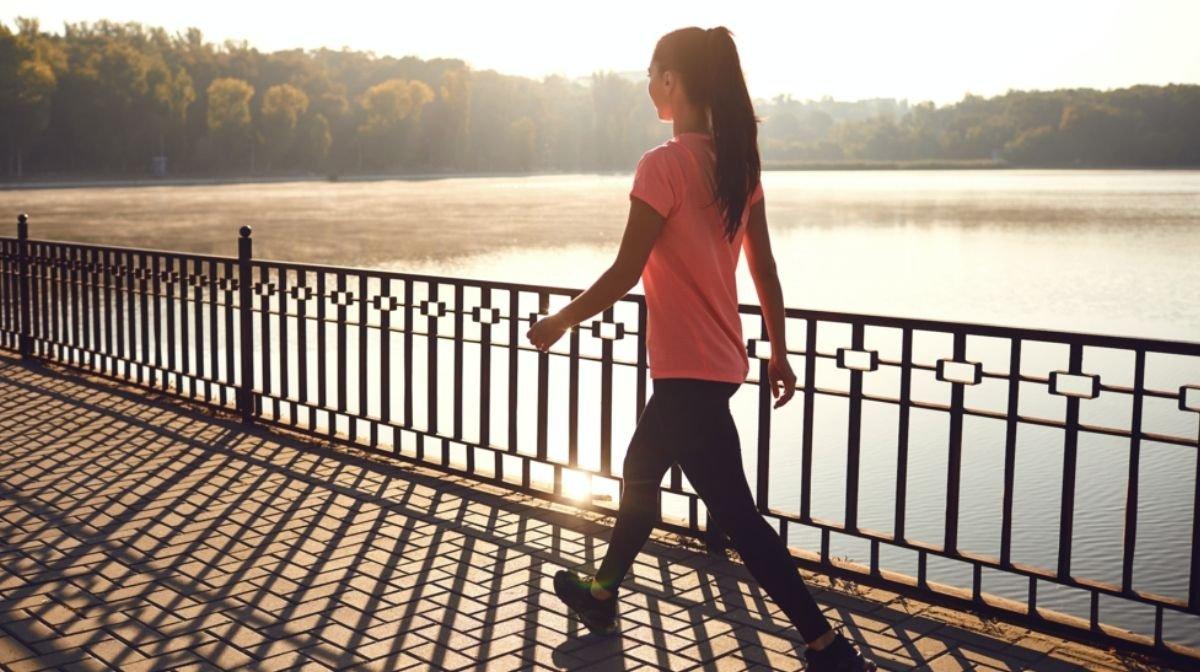 woman walking by river