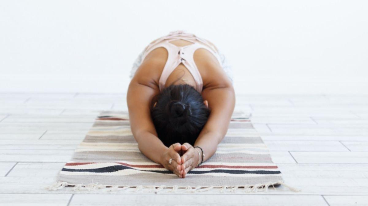 woman practising mindful yoga