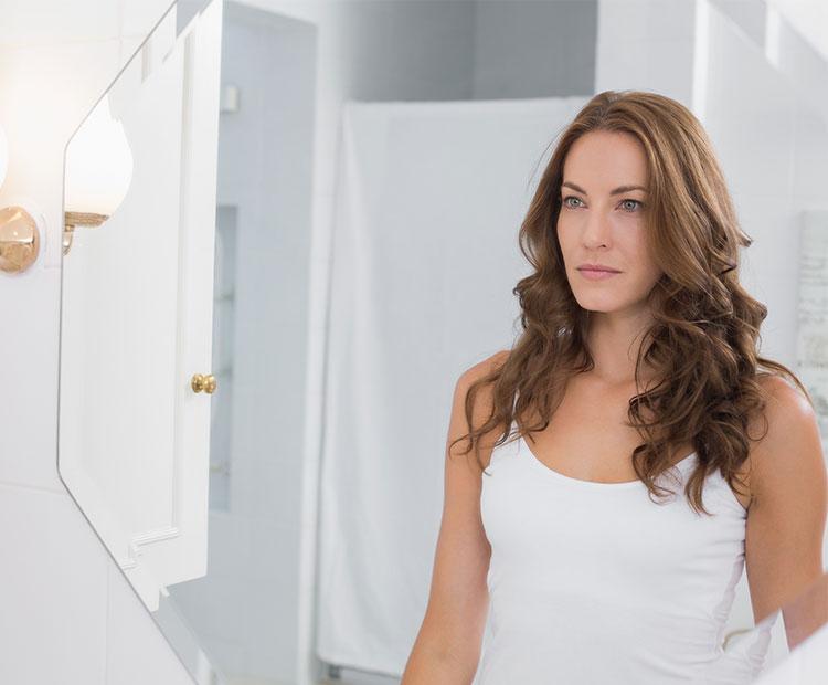 Woman-with-dark-hair-in-the-bathroom-mirror-1
