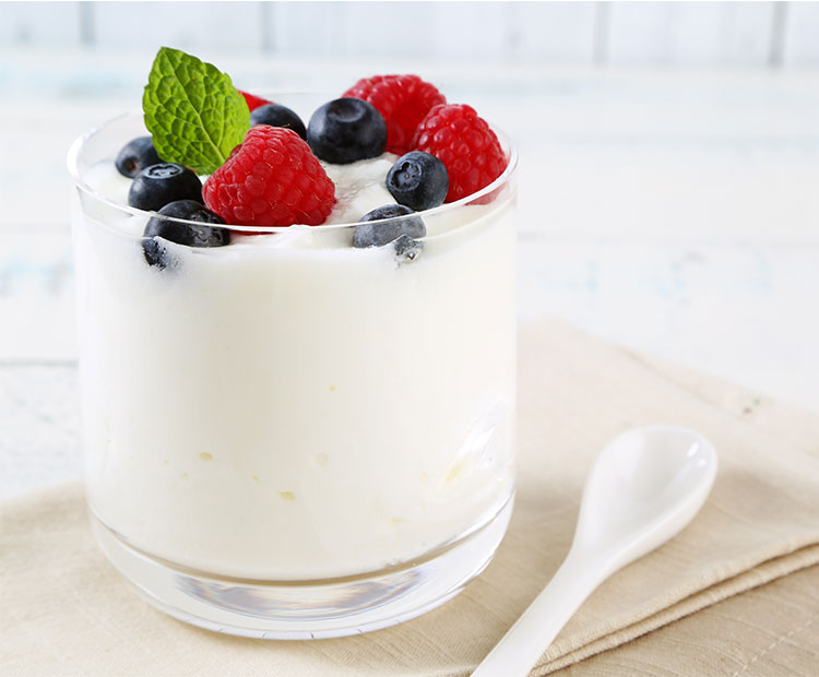 Yogurt-with-fruits-and-spoon-on-a-table-2 | Dermstore Blog
