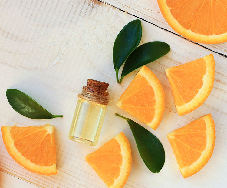 Oil-with-orange-slices-on-a-white-wood-background-2   Dermstore Blog