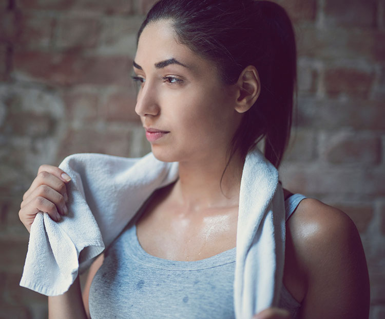 girl sweating after working out I Dermstore Blog