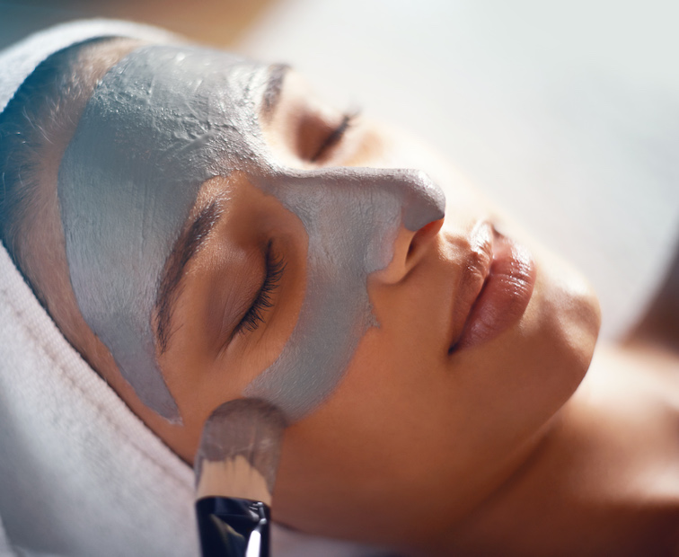 woman with clay face mask