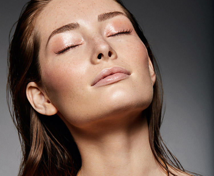 woman with dewy skin and makeup