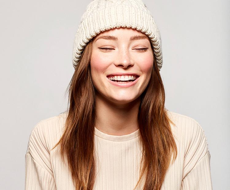 model with white beanie I Dermstore Blog