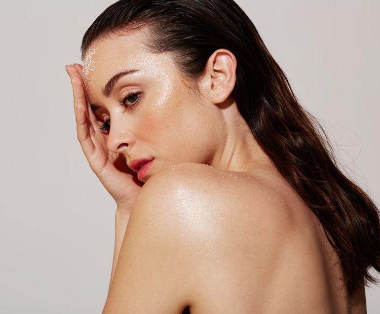 woman using a face scrub