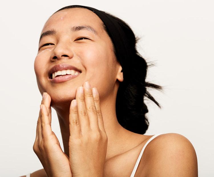 model applying skin care