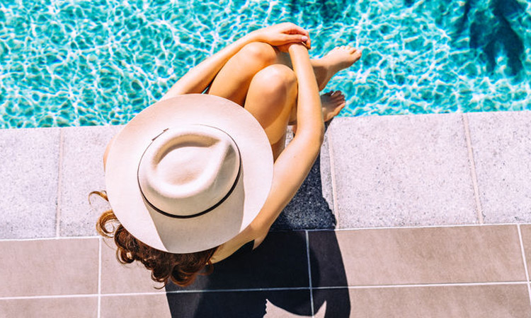9 Poolside Beauty Essentials You Need This Summer