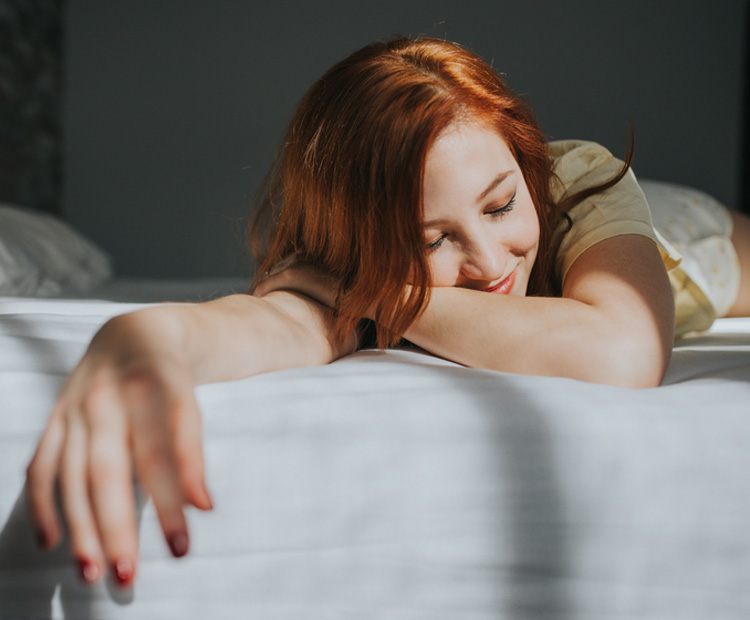 redhead relaxing in bed