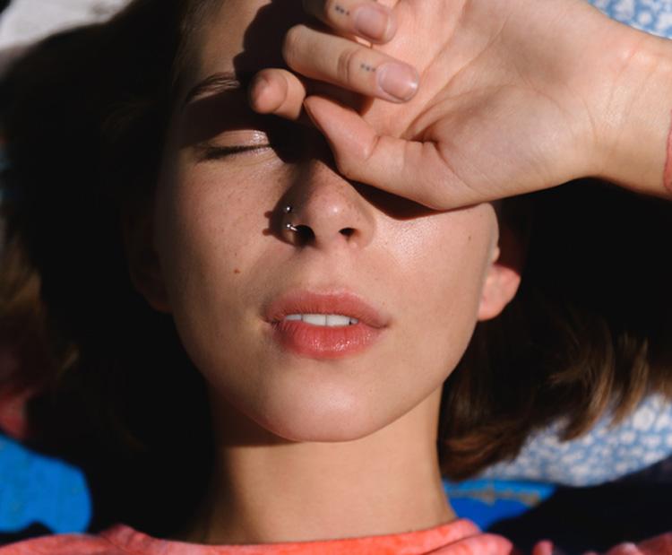 Woman outside in the sun