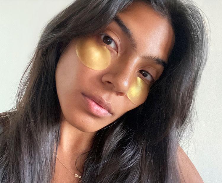 women wearing gold eye gels