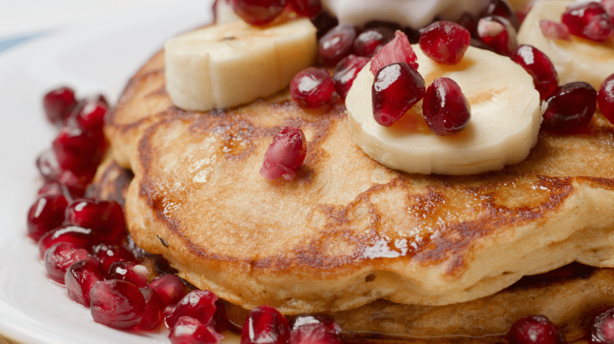 Our healthy pancakes, topped with banana and pomegranate