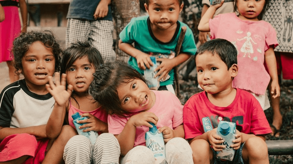 A group of children celebrating Vita Coco Europe's B Corp certification