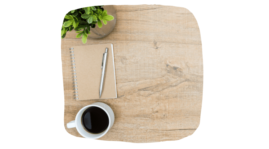desk, journal, and coffee