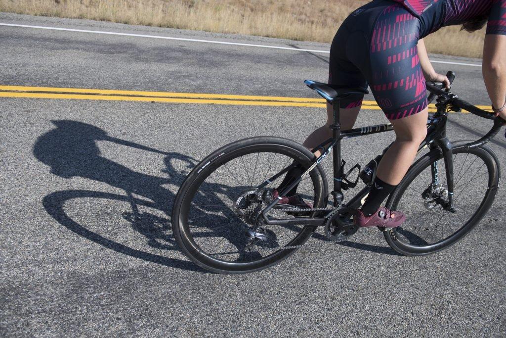 Woman riding Reynolds carbon wheels