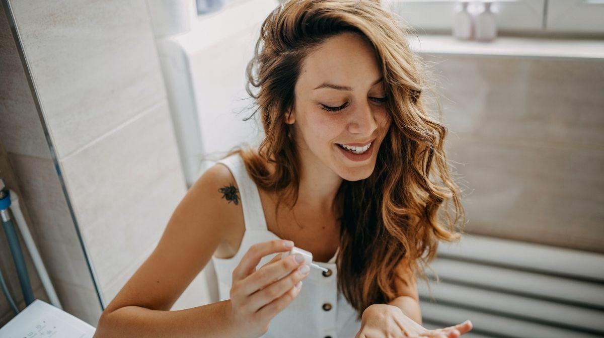 woman applying nail varnish