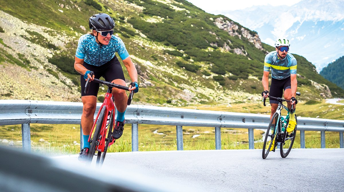 A female cyclist wearing the Women'sPro SL EGM Bibshort and a man next to her wearing Endura gear