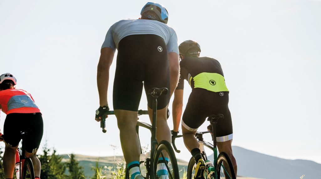 3 cyclists going up a mountain