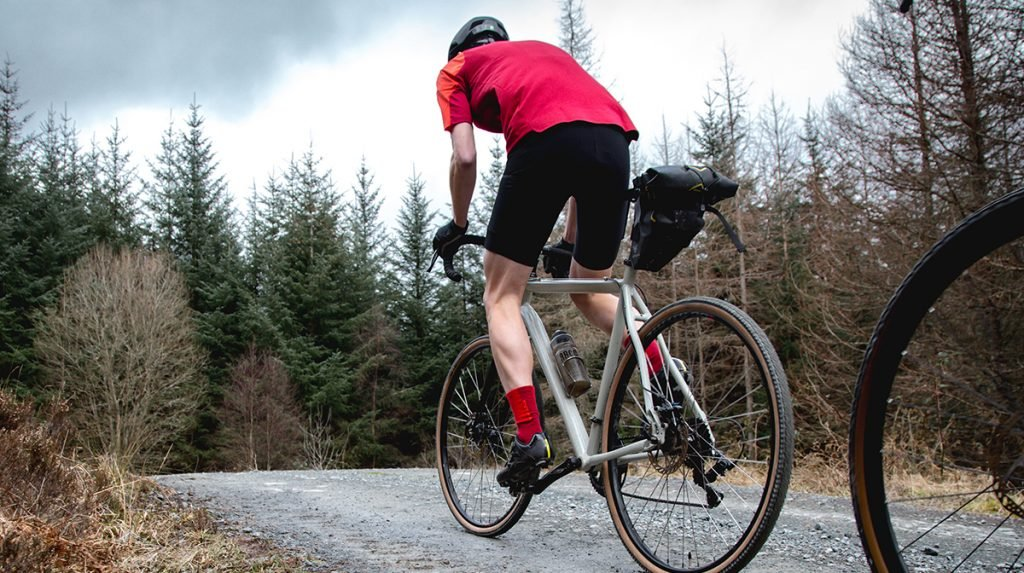 Cyclist travels along road