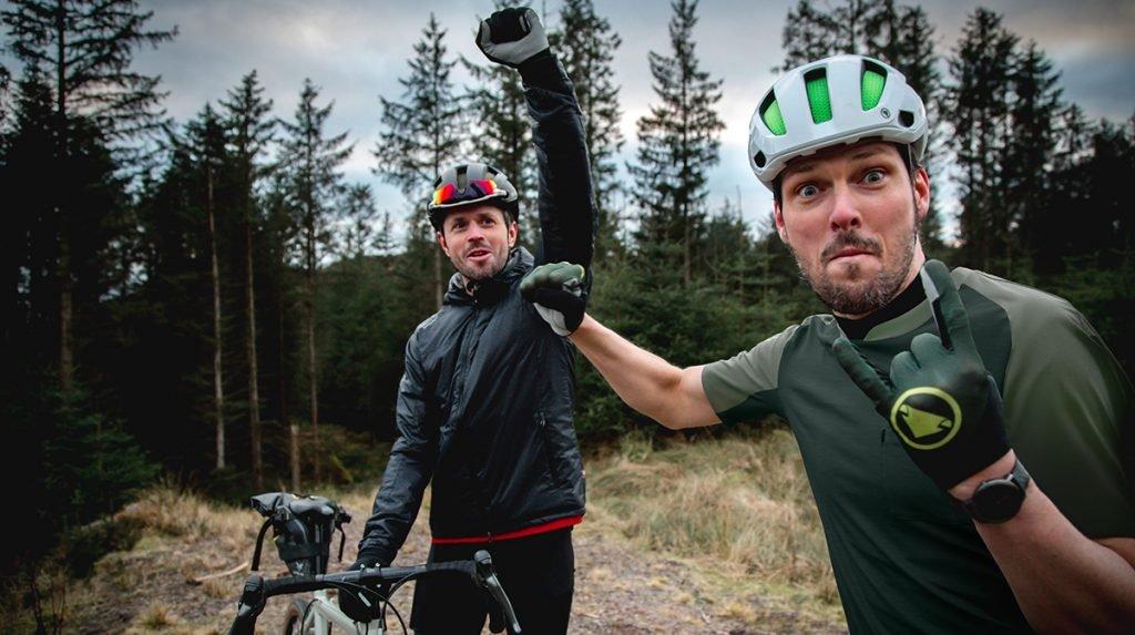 Two cyclists fistbump