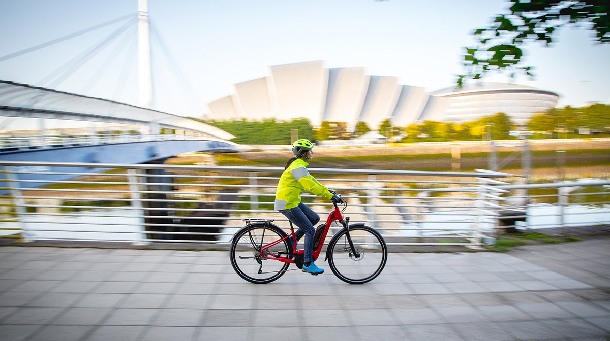 Lady cycle along quayside