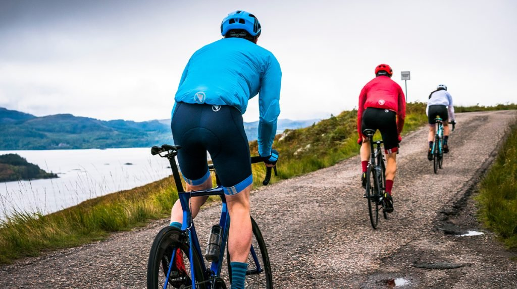Trio of cyclists ascend hill