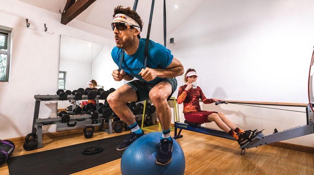 Man balances on top of exercise ball