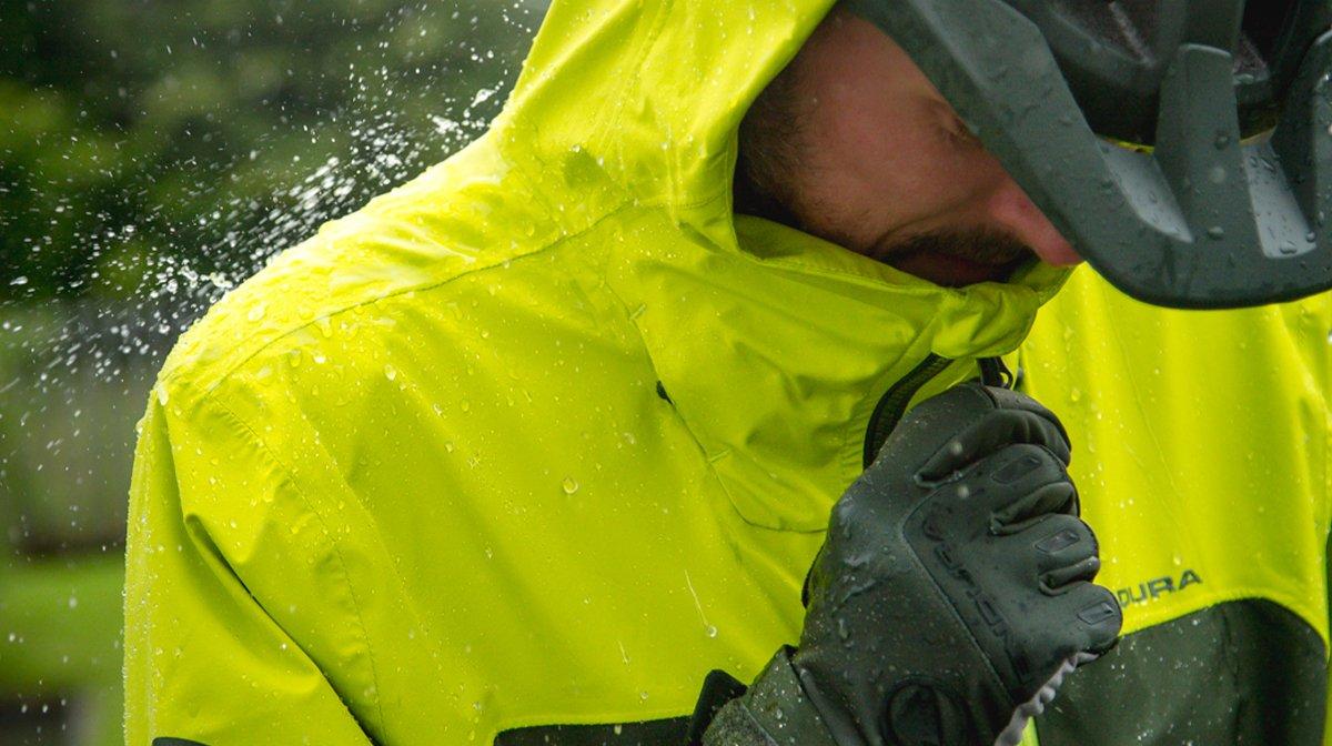 Person zips up yellow waterproof