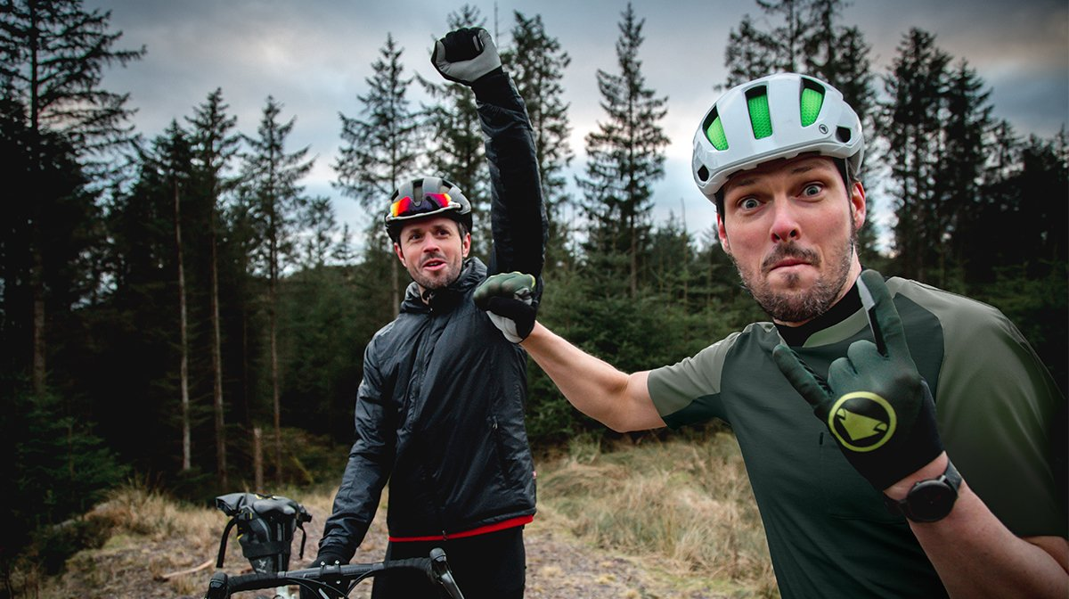 Cyclists fistbump, dressed in Endura from head to toe
