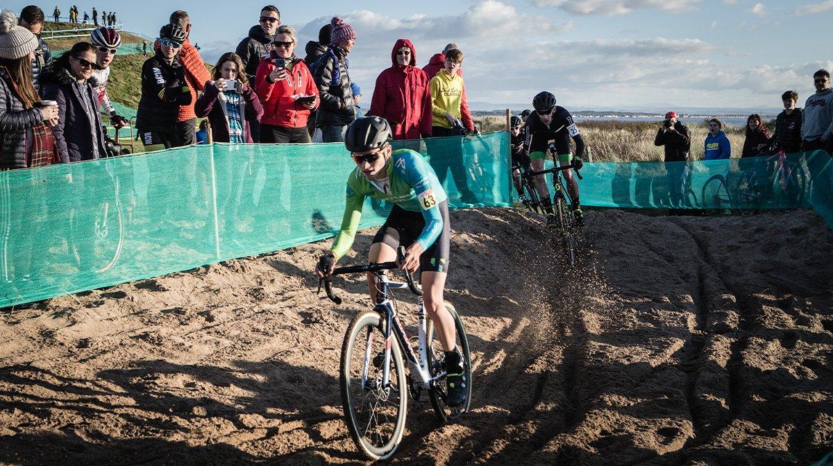 Cyclists ride across sand in Endura gear