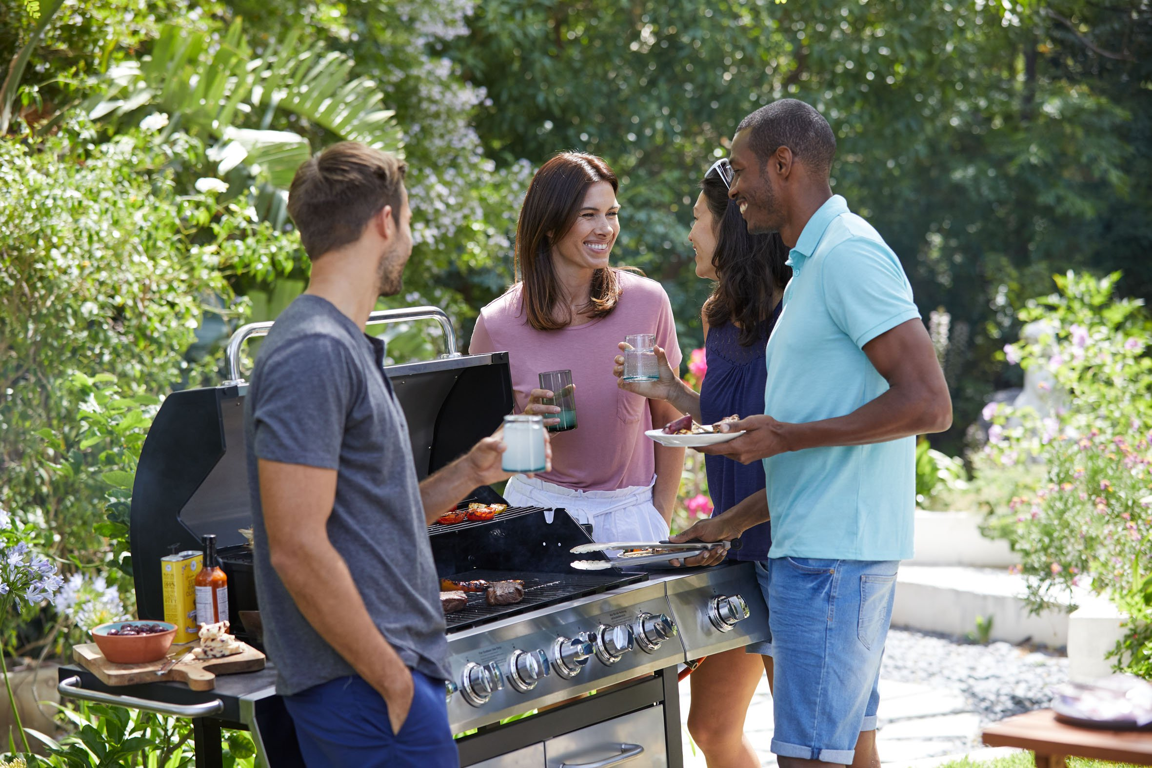 People at a BBQ garden party