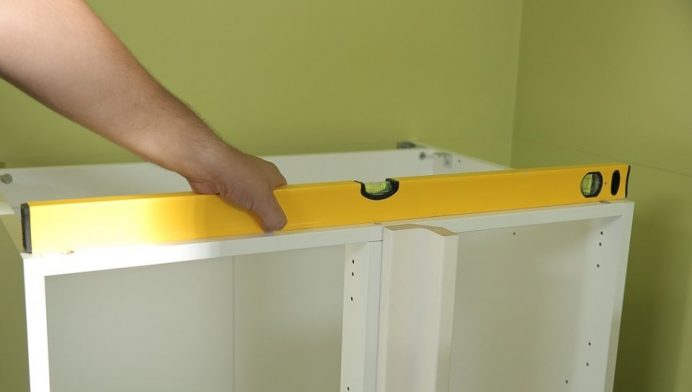 How to Install Cabinets into a Corner