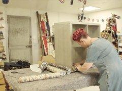 Angel Strawbridge adding wallpaper to mobile storage unit