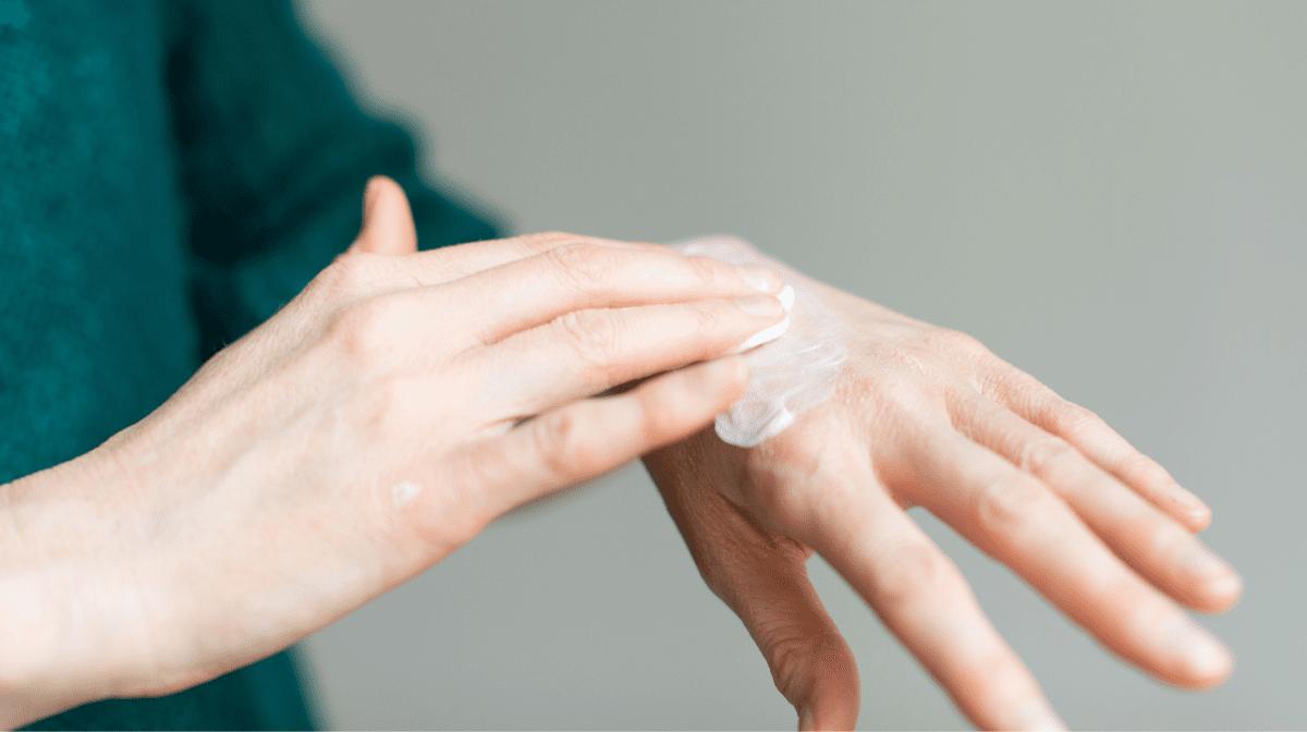 person applying hand cream