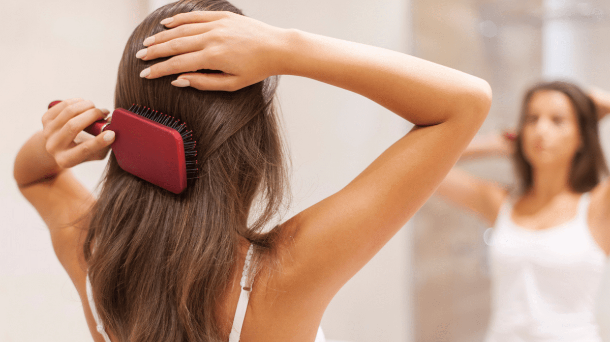 woman brushing healthy hair
