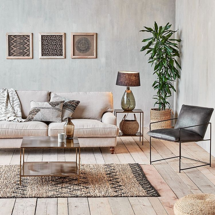 A living room space with a sofa and a chair