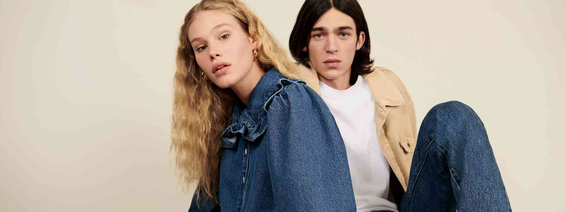 Two people linking arms in Levi denim jackets