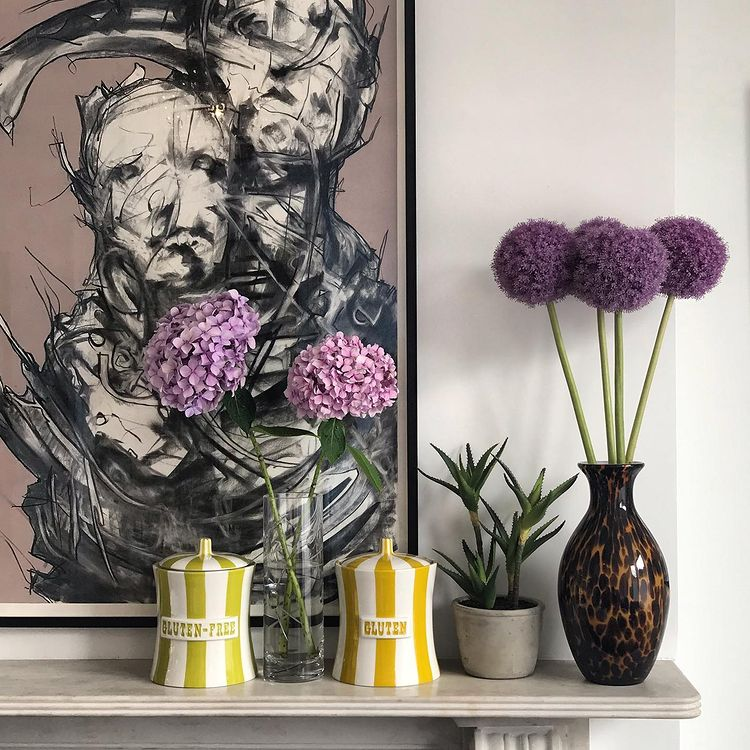 Vases and flowers on a fireplace