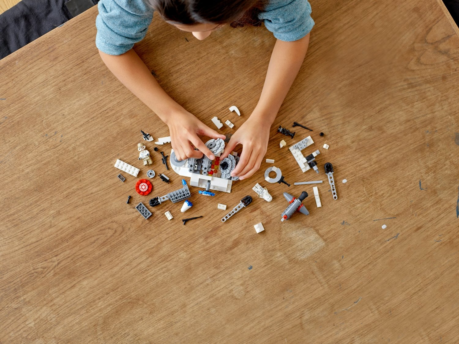 Girl playing with star wars LEGO