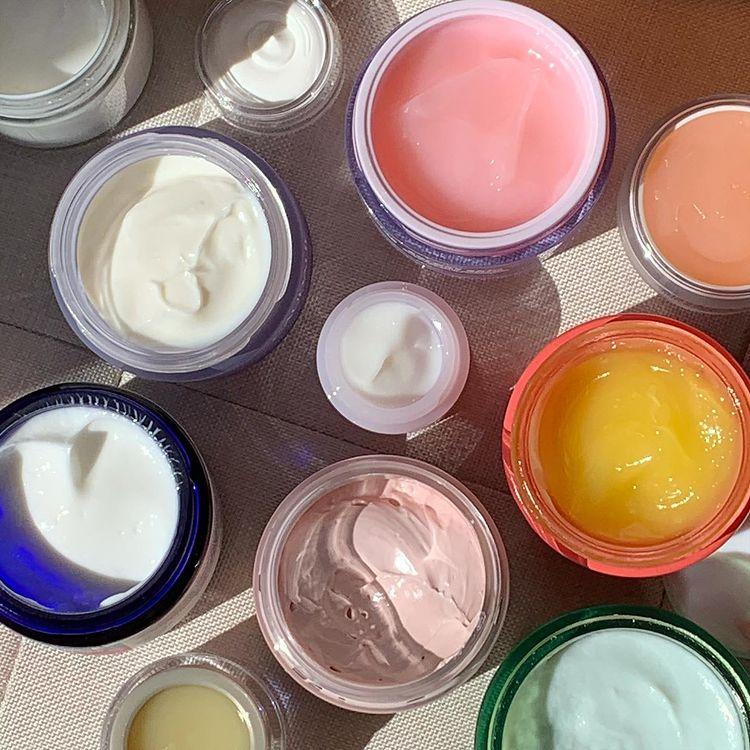 A lot of pots of facial creams open