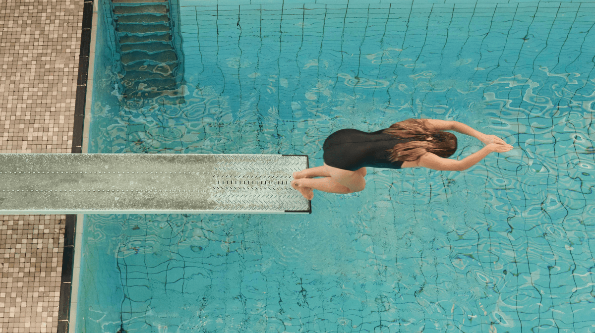 A woman diving into a swimming pool