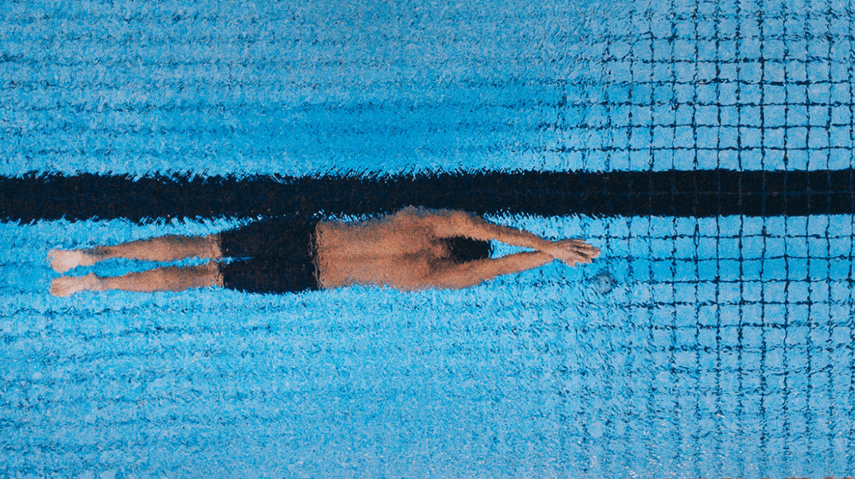 A man swimming in a pool