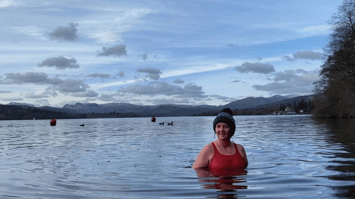 A woman enjoying outdoor swimming