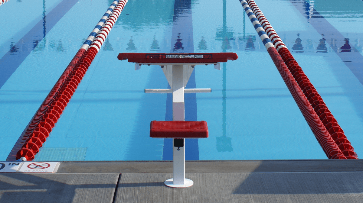 A diving board and a swimming pool